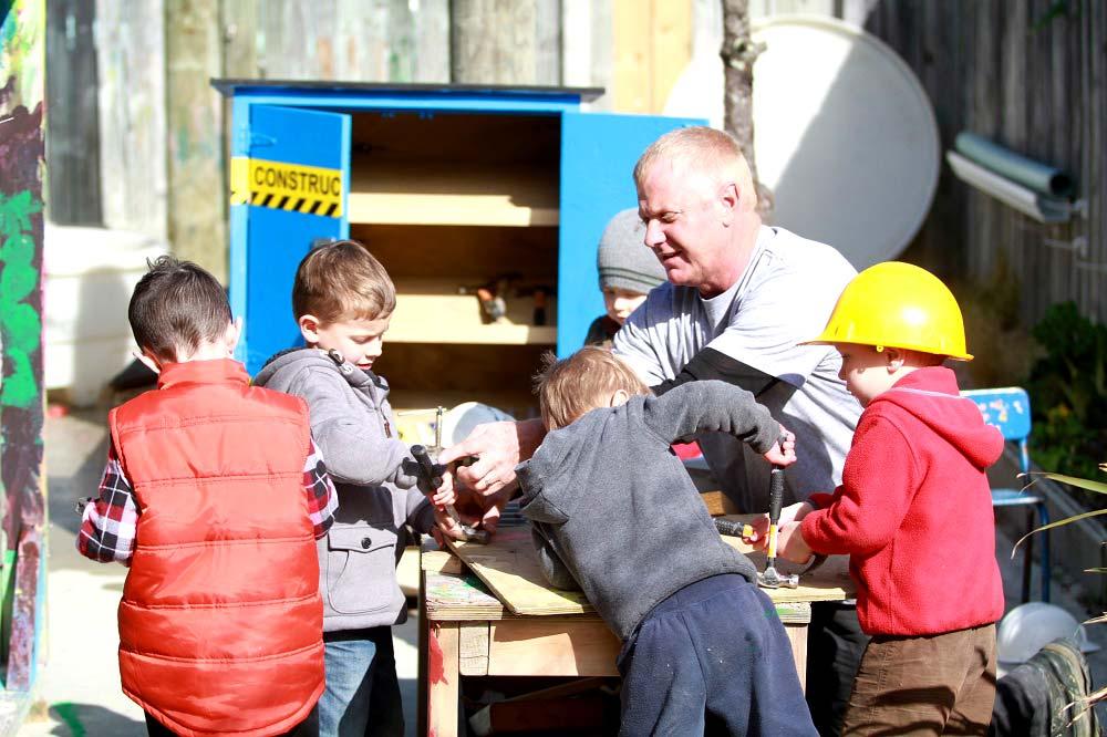 Jason gardiner team working with the kids