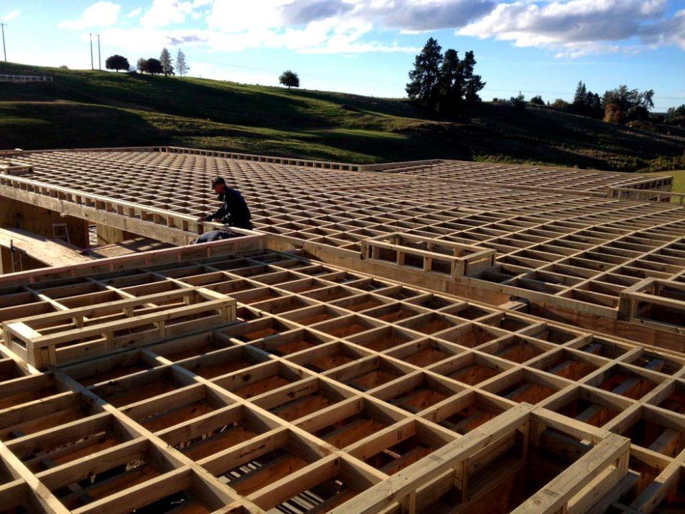 Team member putting together wooden foundation